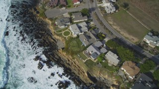 DCSF03_011 - 5K stock footage aerial video Bird's eye view of oceanfront homes, Cambria, California
