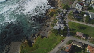 DCSF03_012 - 5K stock footage aerial video Tilt from oceanfront homes to reveal Moon Stone Beach, Cambria, California