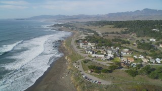 DCSF03_014 - 5K stock footage aerial video Approaching a coastal residential neighborhood, Cambria, California