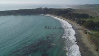DCSF03_018 - 5K stock footage aerial video Fly over William Randolph Hearst Memorial State Beach and San Simeon Pier, San Simeon, California