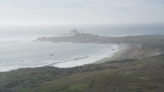 DCSF03_023 - 5K stock footage aerial video Approach beach and Piedras Blacas Light Station, Point Piedras Blancas, California