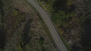 DCSF03_035 - 5K stock footage aerial video Bird's eye view of Highway 1 winding past hills, Big Sur, California