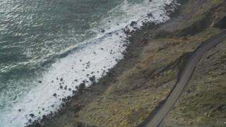 DCSF03_036 - 5K stock footage aerial video Bird's eye view of ocean waves, reveal Highway 1, Big Sur, California