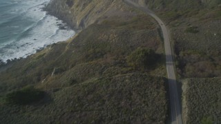 DCSF03_037 - 5K stock footage aerial video Tilt from bird's eye of Highway 1 above the coastline, Big Sur, California