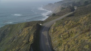 DCSF03_039 - 5K stock footage aerial video Fly over Highway 1 and the edge of a cliff, Big Sur, California