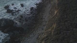 DCSF03_042 - 5K stock footage aerial video Bird's eye view of waves slamming into coastal rock formations, Big Sur, California