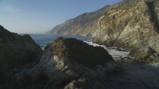DCSF03_051 - 5K stock footage aerial video Pan from coastal cliffs, reveal and fly over rock formations, Big Sur, California