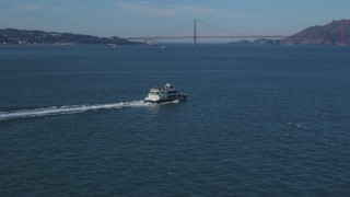 DCSF05_022 - 5K stock footage aerial video Track a ferry cruising San Francisco Bay, California