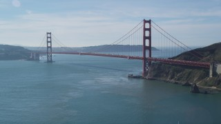 DCSF05_040 - 5K stock footage aerial video Tilting up from San Francisco Bay to reveal Golden Gate Bridge, San Francisco, California