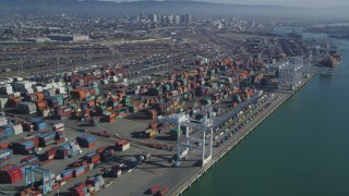 DCSF05_077 - 5K stock footage aerial video Flying by cargo cranes, and stacks of shipping containers, Port of Oakland, Oakland, California