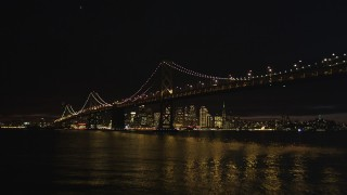DCSF06_002 - 5K stock footage aerial video Approach and fly over Bay Bridge, approach Downtown San Francisco skyline, California, night