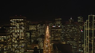 DCSF06_004 - 5K stock footage aerial video Tilt to reveal and approach Ferry Building, Downtown San Francisco skyscrapers, and Market Street, California, night