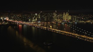 DCSF06_014 - 5K stock footage aerial video Flying by Bay Bridge with the downtown skyline behind it, San Francisco, California, night