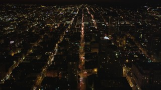 DCSF06_017 - 5K stock footage aerial video following California Street past Huntington Hotel, Grace Cathedral, in Nob Hill, San Francisco, California, night