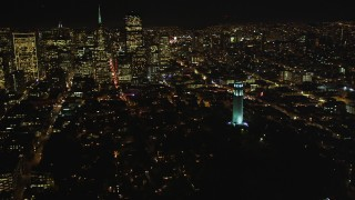 DCSF06_025 - 5K stock footage aerial video Flying by Coit Tower with a view of Transamerica Pyramid, San Francisco, California, night