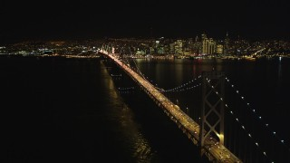 DCSF06_032 - 5K stock footage aerial video Approach heavy traffic on the upper deck of the Bay Bridge, Downtown San Francisco skyline in background, California, night