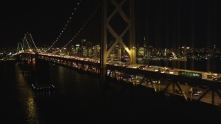 DCSF06_034 - 5K stock footage aerial video Flying by Bay Bridge, San Francisco skyline in the background, California, night