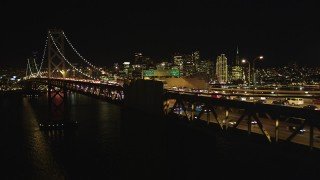 DCSF06_035 - 5K stock footage aerial video Flying by Bay Bridge, focus on San Francisco skyline, California, night