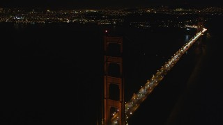 DCSF06_043 - 5K stock footage aerial video Tilt from light traffic to tower of Golden Gate Bridge, San Francisco, California, night