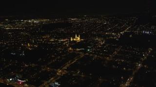 DCSF06_050 - 5K stock footage aerial video Tilt to reveal St. Ignatius Church, Inner Richmond District, San Francisco, California, night
