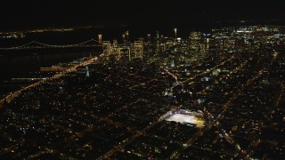 DCSF06_064 - 5K stock footage aerial video Fly high altitude by Coit Tower and Downtown San Francisco, California, night