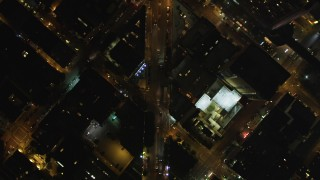 DCSF06_067 - 5K stock footage aerial video Bird's eye view of Columbus Avenue, reveal Transamerica Pyramid, Downtown San Francisco, California, night