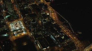 DCSF06_069 - 5K stock footage aerial video Orbit Infinity Towers condominiums, tilt to reveal Downtown San Francisco, California, night