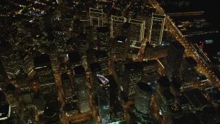 DCSF06_079 - 5K stock footage aerial video Tilt to bird's eye view of downtown skyscrapers around Market Street, San Francisco, California, night