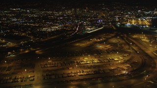 DCSF06_089 - 5K stock footage aerial video Tilt from Port of Oakland to reveal I-880 and Downtown Oakland, California, night