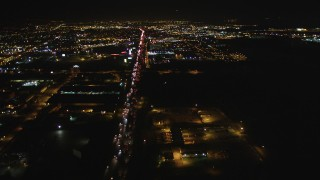 DCSF06_099 - 5K stock footage aerial video Follow Interstate 880 and approach O.co Coliseum, Oracle Arena, Oakland, California, night