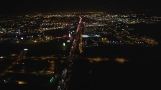 DCSF06_100 - 5K stock footage aerial video Follow I-880 toward O.co Coliseum and Oracle Arena, tilt down, Oakland, California, night