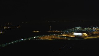 DCSF06_102 - 5K stock footage aerial video Track a small plane landing at Oakland International Airport, Oakland, California, night