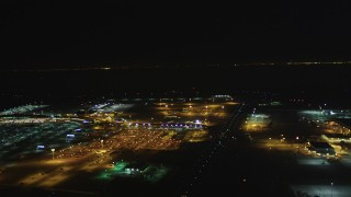 DCSF06_104 - 5K stock footage aerial video Flyby Oakland International Airport and the FedEx Terminal, Oakland, California, night