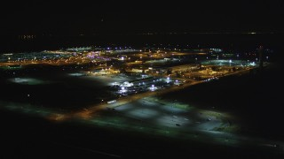 DCSF06_105 - 5K stock footage aerial video Reverse view of Oakland International Airport, Oakland, California, night