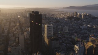 DCSF07_005 - 5K stock footage aerial video Fly past 555 California Street toward Nob Hill high-rises, Downtown San Francisco, California, sunset
