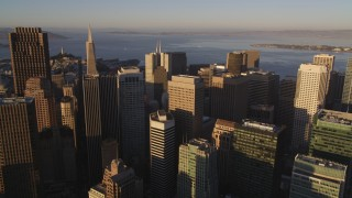 DCSF07_026 - 5K stock footage aerial video Approach 345 California Center and Transamerica Pyramid, Downtown San Francisco, California, sunset