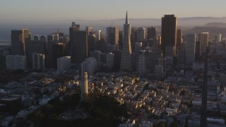 DCSF07_030 - 5K stock footage aerial video Flyby Coit Tower, Transamerica Pyramid and Downtown San Francisco, California, sunset