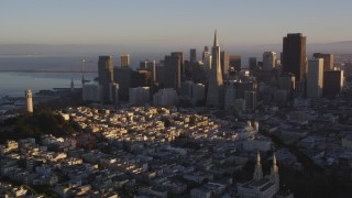 DCSF07_031 - 5K stock footage aerial video Flying away from Coit Tower and the downtown skyline, Downtown San Francisco, California, sunset