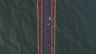 DCSF07_042 - 5K stock footage aerial video Bird's eye view of light traffic on the Golden Gate Bridge, San Francisco, California, sunset