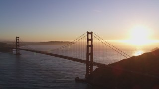 DCSF07_043 - 5K stock footage aerial video Reverse view of the Golden Gate Bridge, San Francisco, California, sunset
