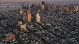 DCSF07_057 - Aerial stock footage of 5K Aerial Video Tilt from Russian Hill apartment buildings to reveal Downtown San Francisco, California, twilight