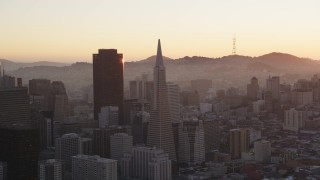 DCSF07_064 - Aerial stock footage of 5K Aerial Video 555 California Street skyscraper and Transamerica Pyramid, Downtown San Francisco, California, sunset