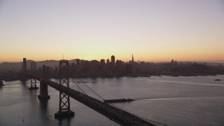 DCSF07_071 - Aerial stock footage of 5K Aerial Video Bay Bridge and the skyline of Downtown San Francisco, California, twilight