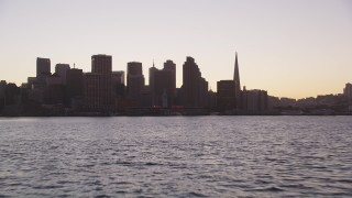 DCSF07_072 - Aerial stock footage of 5K Aerial Video Low altitude approach to Ferry Building and Downtown San Francisco skyline, California, twilight