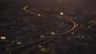 DCSF07_089 - Aerial stock footage of 5K Aerial Video Heavy traffic on Interstate 80 by SFPD and County Jail, South of Market, San Francisco, California, twilight