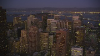 DCSF07_093 - Aerial stock footage of 5K Aerial Video Fly over skyscrapers to approach the Bay Bridge, Downtown San Francisco, California, night