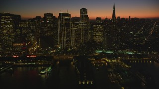DCSF07_113 - Aerial stock footage of 5K Aerial Video Passing by Downtown San Francisco and Transamerica Pyramid, California, twilight