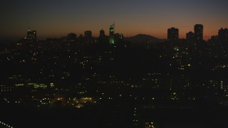 DCSF07_114 - Aerial stock footage of 5K Aerial Video Flying by Coit Tower, North Beach, San Francisco, California, night