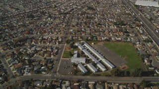 DCSF08_001 - Aerial stock footage of 5K Aerial Video Fly away from Corvallis Elementary School and suburban neighborhoods, San Leandro, California