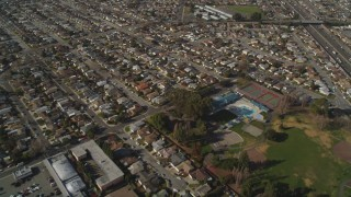 DCSF08_002 - Aerial stock footage of 5K Aerial Video Reverse view of residential neighborhoods and Washington Manor Park, San Leandro, California